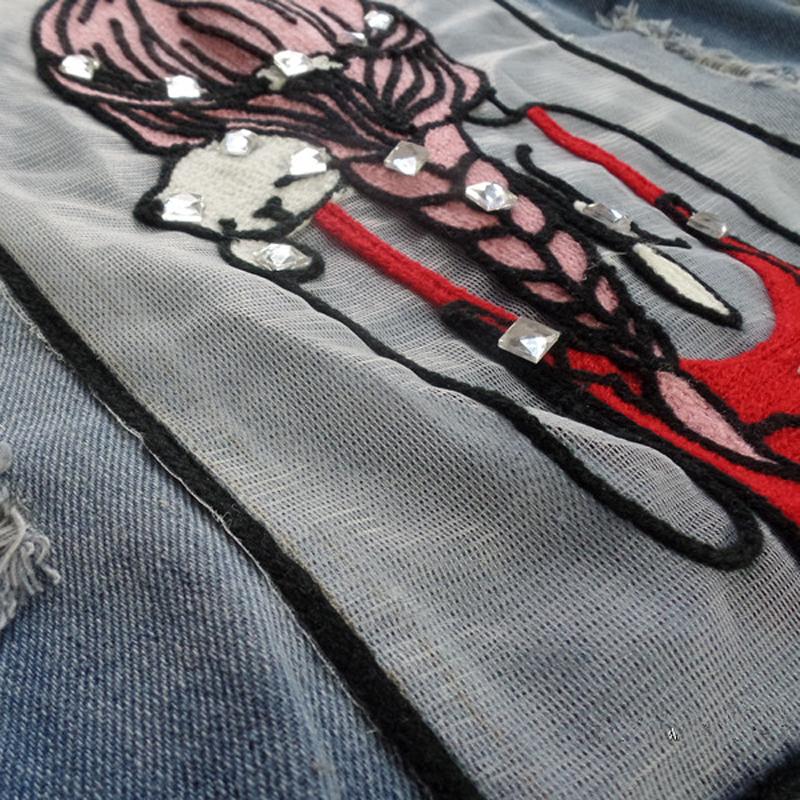 Motifs décoration diamants sur veste en jean fashion pour fille