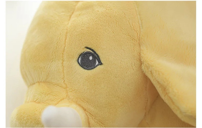 Peluche éléphant jaune - zoom sur le visage