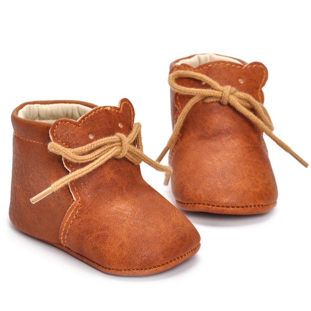 Chaussures pour bébé en cuir marron